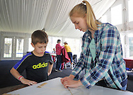 Ryan Crawford, 8, gets help from Jaclyn McDowell, both of Doylestown, Pennsylvania while making a kite during Kite Day Sunday April 24, 2016 at the Fonthill Museum in Doylestown, Pennsylvania. (Photo by William Thomas Cain/Cain Images)