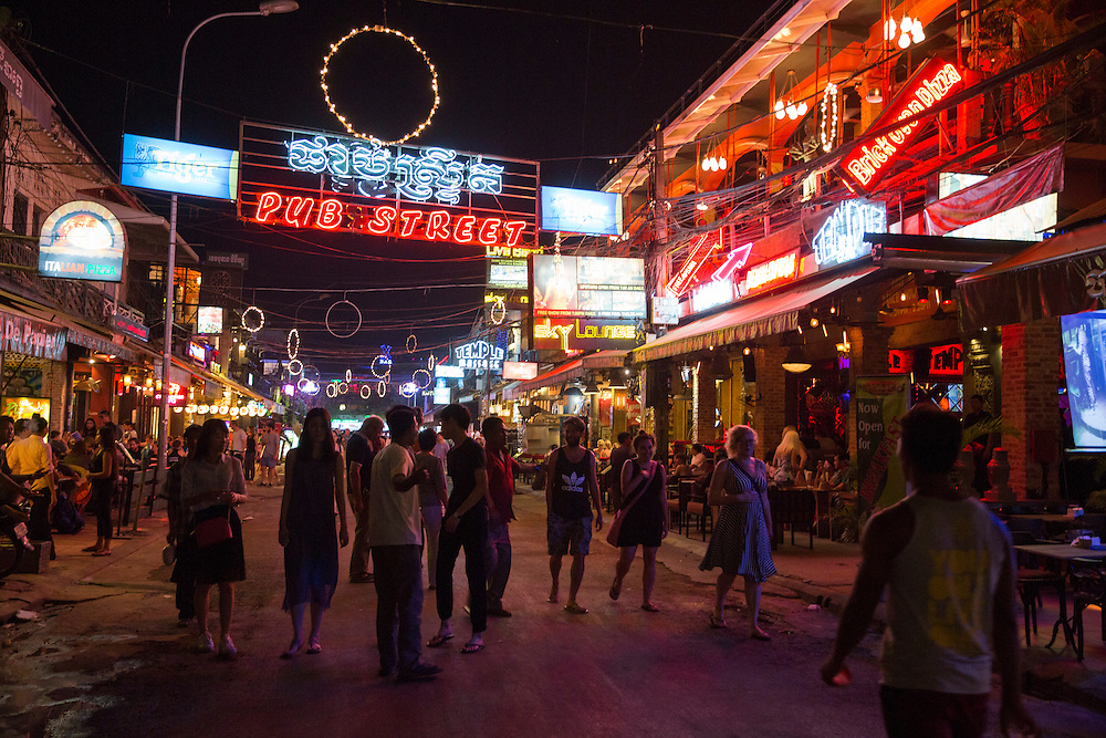 Tourists walk past shops, restaurant and bars at night on Pub Street in downtown Siem Reap, Cambodia, Asia. Siem Reap is the capital city of the Siem Reap Province.  Pub Street is a famous destination for lively nightlife for tourist and travellers as it restaurants and bars stay open late. (photo by Andrew Aitchison / In pictures via Getty Images)