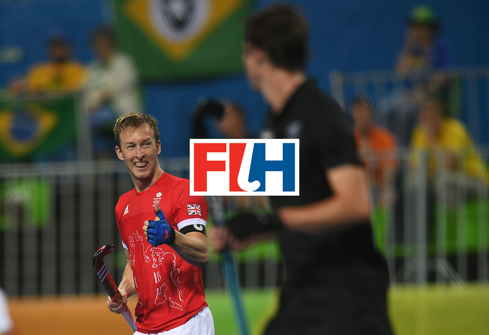 Britain's Barry Middleton (L) gestures during the men's field hockey Britain vs New Zealand match of the Rio 2016 Olympics Games at the Olympic Hockey Centre in Rio de Janeiro on August, 7 2016. / AFP / MANAN VATSYAYANA        (Photo credit should read MANAN VATSYAYANA/AFP/Getty Images)