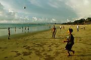 Jimbaran Beach. Boys from a fishing village playing soccer.