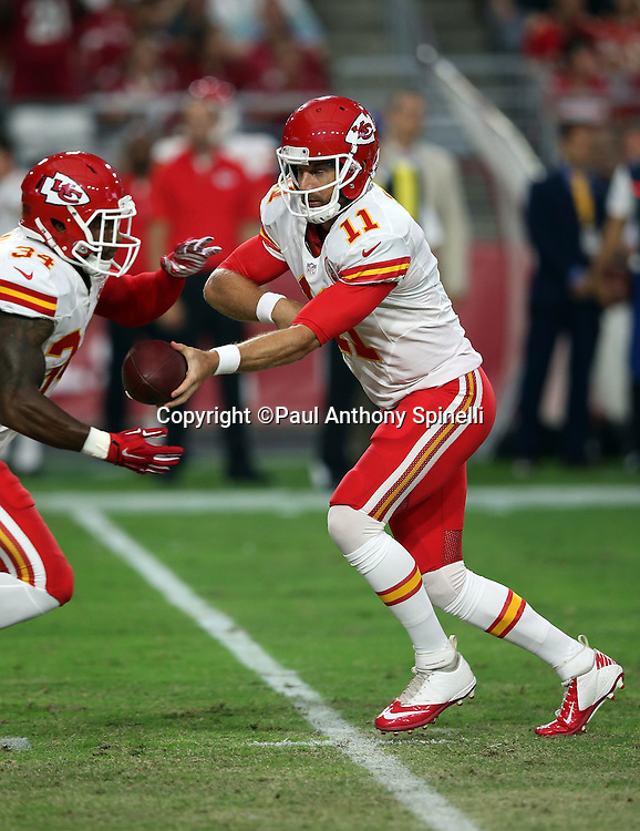Kansas City Chiefs quarterback Alex Smith (11) hands off the ball to Kansas City Chiefs running back Knile Davis (34) during the 2015 NFL preseason football game against the Arizona Cardinals on Saturday, Aug. 15, 2015 in Glendale, Ariz. The Chiefs won the game 34-19. (©Paul Anthony Spinelli)