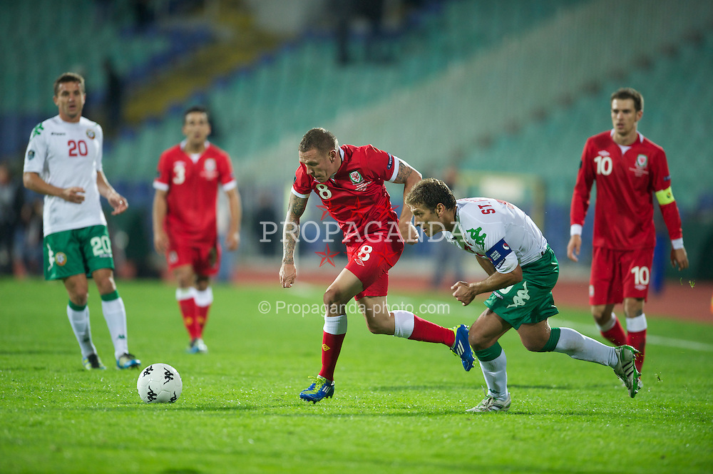 SOFIA, BULGARIA - Tuesday, October 11, 2011: Wales' Craig Bellamy in action against Bulgaria's captain Stilyan Petrov during the UEFA Euro 2012 Qualifying Group G match at the Vasil Levski National Stadium. (Pic by David Rawcliffe/Propaganda)