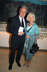 MICHAEL ASPELL and IRENE CLARK at the Lady Taverners Tribute lunch in honour of Ronnie Corbett held at The Dorchester Hotel, Park Lane, London on 3rd November 2006.<br />