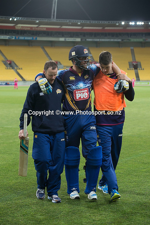 Sam Wells of the Volts is helped from the field after being injured during the Georgie Pie Super Smash Volts v Knights cricket match at the Westpac Stadium in Wellington on Sunday the 23rd of November 2014. Photo by Marty Melville/www.Photosport.co.nz