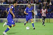 AFC Wimbledon defender George Francomb (7) dribbling during the EFL Cup match between AFC Wimbledon and Brentford at the Cherry Red Records Stadium, Kingston, England on 8 August 2017. Photo by Matthew Redman.