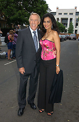 BRUCE FORSYTH and his wife WILNELIA at Sir David & Lady Carina Frost's annual summer party held in Carlyle Square, Chelsea, London on 5th July 2006.<br />