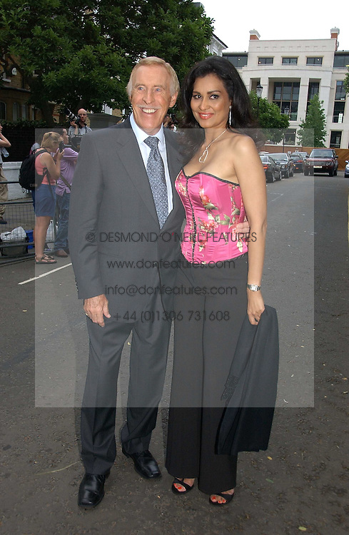 BRUCE FORSYTH and his wife WILNELIA at Sir David & Lady Carina Frost's annual summer party held in Carlyle Square, Chelsea, London on 5th July 2006.<br /><br />NON EXCLUSIVE - WORLD RIGHTS