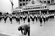 Xinjiiang Uygur Autonomous region. Kashgar. Department store workers exercise before opening time.