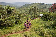 Children from one of the local Batwa tribal community gather for the funeral Matale, a local woman.