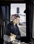 Fascinating Color Portrait Photos of Women Railroad Workers During WWII<br /> <br /> World War II began when Hitler's army invaded Poland on September 1, 1939. However, it wasn't until the day after the Japanese attacked Pearl Harbor on December 7, 1941, that the United States declared war on the Axis Powers.<br /> <br /> The railroads immediately were called upon to transport troops and equipment heading overseas. Soon the efforts increased to supporting war efforts on two fronts-- in Europe and in the Pacific.<br /> <br /> Prior to the 1940s, the few women employed by the railroads were either advertising models, or were responsible primarily for cleaning and clerical work. Thanks to the war, the number of female railroad employees rose rapidly. By 1945, some 116,000 women were working on railroads. A report that appeared on the 1943 pages of Click Magazine regarding the large number of American women who had stepped forward to see to it that the American railroads continued to deliver the goods during the Second World War:<br /> <br />     &quot;Nearly 100,000 women, from messengers aged 16 to seasoned railroaders of 55 to 65, are keeping America's wartime trains rolling. So well do they handle their jobs that the railroad companies, once opposed to hiring any women, are adding others as fast as they can get them...&quot;<br /> <br /> In April 1943, Office of War Information photographer Jack Delano photographed the women of the Chicago &amp; North Western Railroad roundhouse in Clinton, Iowa, as they kept the hulking engines cleaned, lubricated and ready to support the war effort.<br /> <br /> Photo shows: Cloe Weaver, mother of four, a roundhouse helper training to operate the turntable.<br /> &copy;Library of Congress/Exclusivepix Media