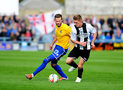 Bristol Rovers' Andy Monkhouse is challenged by Dorchester Town's Sam Lanahan - Photo mandatory by-line: Neil Brookman/JMP - Mobile: 07966 386802 - 25/10/2014 - SPORT - Football - Dorchester - The Avenue Stadium - Dorchester Town v Bristol Rovers - FA Cup Qualifying with Budweiser