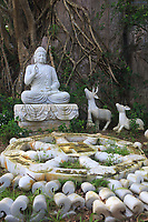 Buddha surrounded by wildlife in the gardens of Thuy Son Mountain, Da Nang, Vietnam
