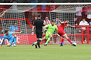 Ollie Palmer scores the winning goal past Scott Flinders   during the EFL Sky Bet League 2 match between Crawley Town and Cheltenham Town at The People's Pension Stadium, Crawley, England on 31 August 2019.