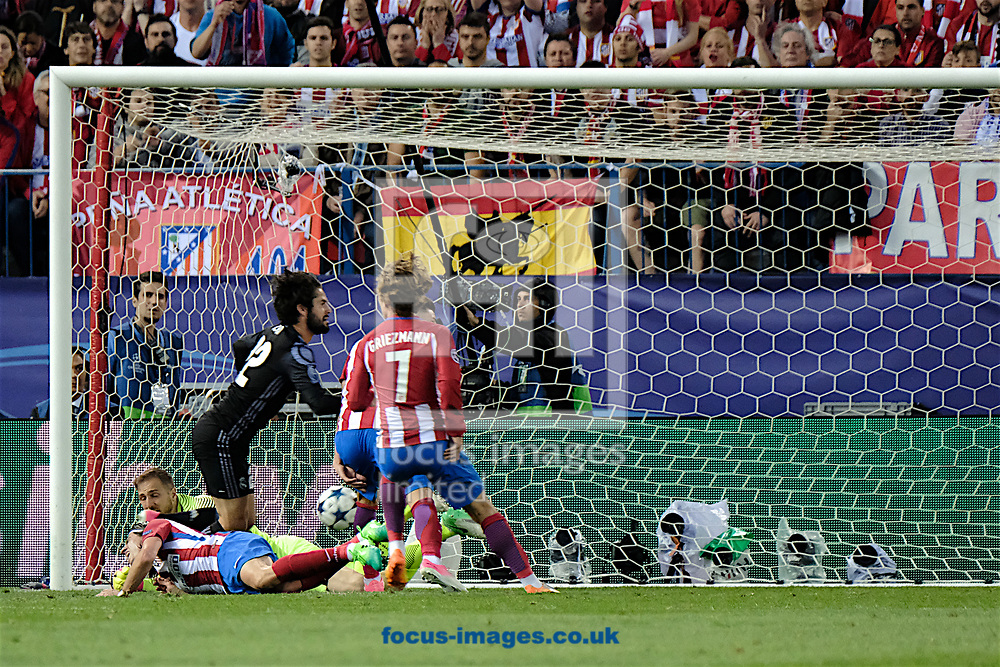 Isco of Real Madrid (2nd left) scores their first goal to make it Atletico Madrid 2 Real Madrid 1 during the second leg of the UEFA Champions League semi-final at Vicente Calderon Stadium, Madrid<br /> Picture by Kristian Kane/Focus Images Ltd +44 7814 482222<br /> 10/05/2017