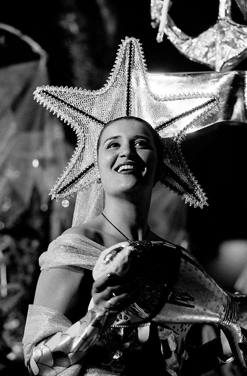 """A girl smiles during the Parade in Liberdade Avenue. Bica neighbourhood march was inspired in traditional fishsellers that used to work in the neighbourhood. The Parade is observed by a jury that gives points to each March. usually Bica is classified in the first places Every 12th of June, Lisbon's typical neighbourhoods show their """"marches"""". These consist on music, coreography and costumes inspired on each neighbourhood traditions. The streets of each old Lisbon neighbourhood gets crowded with people partying. The smell of grilled sardines fills the air as people celebrate Saint Anthony's day, (13th June) Lisbon's patron saint."""