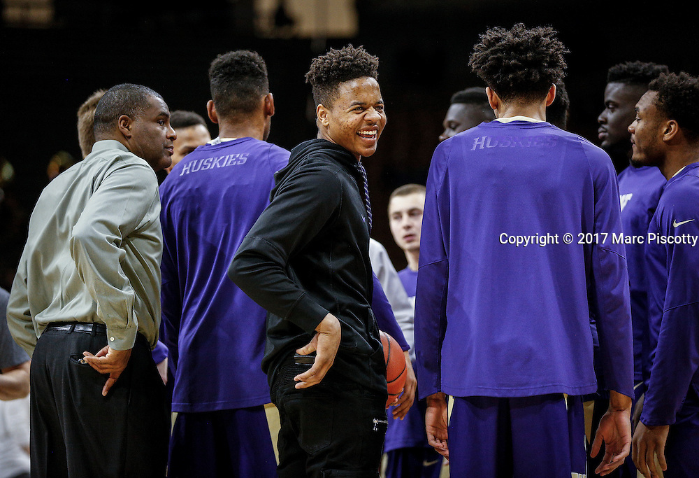 SHOT 2/9/17 8:34:57 PM - Washington's Markelle Fultz  (center) laughs at a teammate during warmups prior to their regular season Pac-12 college basketball game against Colorado at the Coors Events Center in Boulder, Co. Colorado won the game 81-66. Fultz, who did not play in the game due to illness, is projected by many to be the top overall pick in the 2017 NBA Draft. (Photo by Marc Piscotty / © 2017)