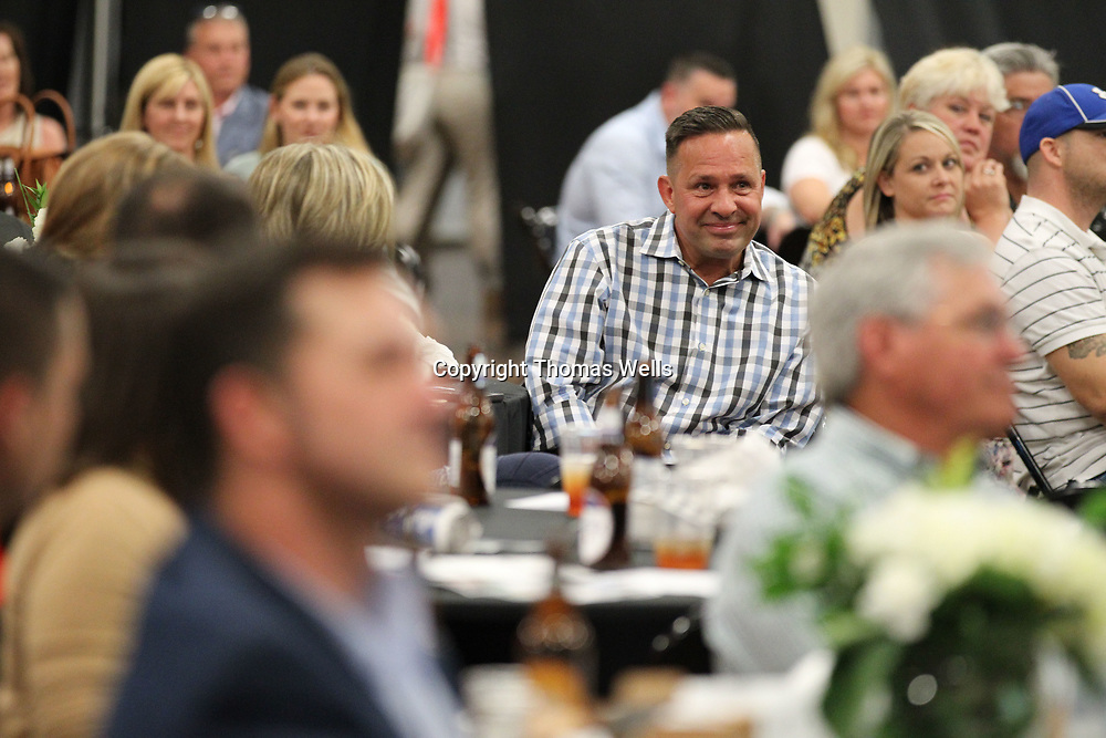 Steve Tybor fights back tears as his name is announced as this year's winner of the Community Helper Award to conclude Thursday's Daily Journal Reader's Choice Awards Banquet at the Tupelo Furniture Market.