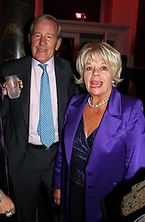 NEIL DURDEN-SMITH and JUDITH CHALMERS at a party hosted by jeweller Theo Fennell and Dominique Heriard Dubreuil of Remy Martin fine Champagne Cognac entitles 'Hot Ice' held at 35 Belgrave Square, London, W1 on 26th October 2004.<br /><br />NON EXCLUSIVE - WORLD RIGHTS