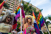 """A drag queen holds her beer aloft at LGBT Pride. The annual march through Taipei's city streets is the largest in Asia, with well over 50 000 people taking part. The 2014 event had the theme """"Walk in Queer's Shoes"""", to encourage the wider community to lend their support for equal marriage rights."""