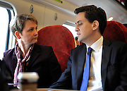 © Licensed to London News Pictures. 16/03/2012. London, UK. Ed Miliband talks to Yvette Cooper on board the train.  Leader of the Labour Party, Ed Miliband and members of his Shadow Cabinet travel to Labour's Youth Conference in Coventry this morning, 16 March 2012, by train from London Euston Station. Photo credit : Stephen SImpson/LNP