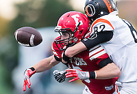 Elkhorn, Nebraska --<br /> <br /> Elkhorn's Alex Schiefelbein (5) fumbles the ball as Beatrice Kyle Leners (82) makes the tackle during their football game at Elkhorn High School on Friday, Sept. 9, 2016, in Elkhorn. Elkhorn recovered the ball. Elkhorn defeated Beatrice 42-7.<br /> <br /> MATT DIXON/THE WORLD-HERALD