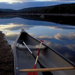Pemadumcook Lake, ME. Northern Forest. Canoeing. A canoe rests on the shore.