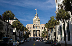 City Hall with golden dome and American Flag on top lined by palm trees, Savannah, Georgia, United States of America.