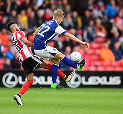 Barrow's Ryan Yates shields the ball from Lincoln City's Nathan Arnold<br /> <br /> Picture: Chris Vaughan/Chris Vaughan Photography<br /> <br /> Football - Vanarama National League - Lincoln City Vs Barrow - Saturday 17th September 2016 - Sincil Bank - Lincoln<br /> <br /> Copyright © 2016 Chris Vaughan Photography. All rights reserved. Unit 11, Churchill Business Park, Bracebridge Heath, Lincoln, LN4 2FF - Telephone: 07764170783 - info@chrisvaughanphotography.co.uk - www.chrisvaughanphotography.co.uk