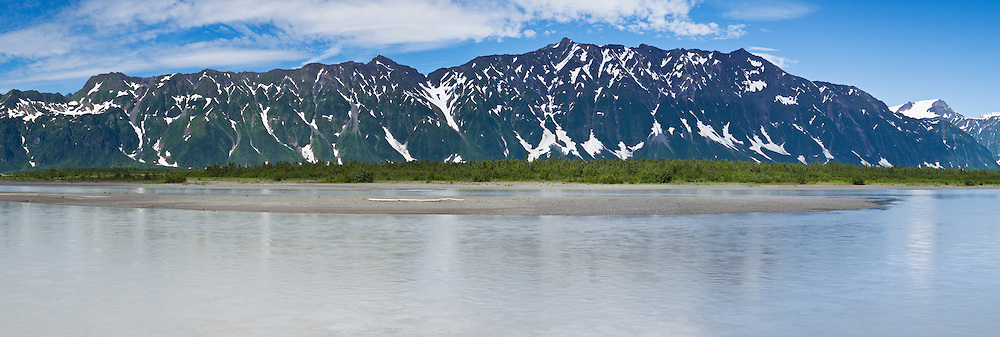Panoramic composite of Chugach Mountains in Copper River Delta of Prince William Sound in Southcentral Alaska. Afternoon. Summer.
