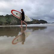 Surfers at  Sandy Bay, Northland, New Zealand,  23rd November 2010 Photo Tim Clayton..