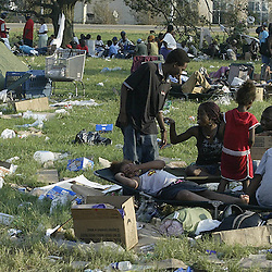 Hundreds displaced by Hurricane Katrina camp out in an area next to interstate 10 as they wait to be taken to safety out of the area during a helicopter pickup at the Causeway on Interstate 10 during the aftermath of Hurricane Katrina Friday, September 2, 2005 in New Orleans, Louisiana.  <br /> (Pasadena Star-News Keith Birmingham)