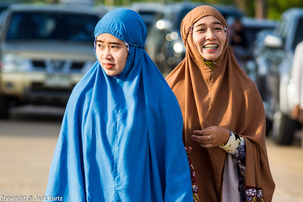 Women walk into Eid al-Fitr services at Songkhla Central Mosque in Songkhla province of Thailand. Eid al-Fitr is also called Feast of Breaking the Fast, the Sugar Feast, Bayram (Bajram), the Sweet Festival and the Lesser Eid, is an important Muslim holiday that marks the end of Ramadan, the Islamic holy month of fasting.