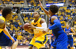 Jan 24, 2017; Morgantown, WV, USA; West Virginia Mountaineers forward Sagaba Konate (50) drives down the lane during the second half against the Kansas Jayhawks at WVU Coliseum. Mandatory Credit: Ben Queen-USA TODAY Sports