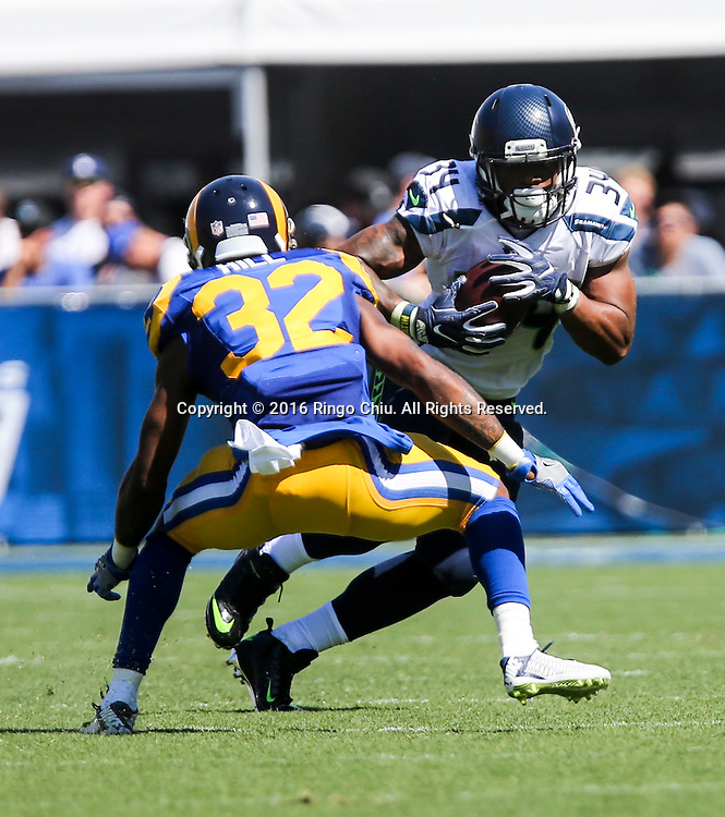 Seattle Seahawks running back Thomas Rawls (34) is defended by Los Angeles Rams cornerback Troy Hill (32) during a NFL football game, Sunday, Sept. 18, 2016, in Los Angeles. The Rams won 9-3.(Photo by Ringo Chiu/PHOTOFORMULA.com)<br /> <br /> Usage Notes: This content is intended for editorial use only. For other uses, additional clearances may be required.