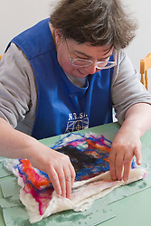 Felt making class for people with a visual impairment - opening pocket in felted wool design.