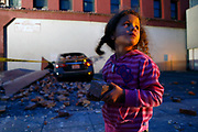McKenzie Edwards, 4, holds a souvenir brick that fell from Novelli Bail Bonds after an earthquake in Napa, Calif. on Sunday, August 24, 2014,