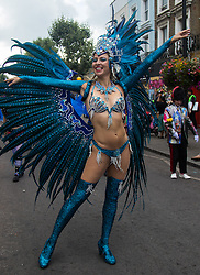 London, August 29th 2016. A woman poses for the camera during day two of Europe's biggest street party, the Notting Hill Carnival.