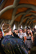 A crowd of people gather inside an inflatable church, Boomtown, Matterley Estate, Alresford Road, Winchester, Hampshire, UK, August, 2010