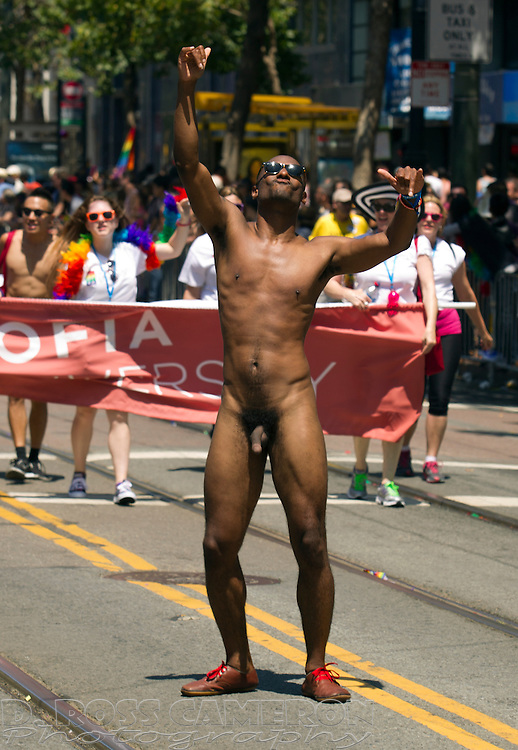 An unidentified naked man dances along Market Street at the 43rd annual San Francisco Pride parade, Sunday, June 30, 2013 in San Francisco. (Photo by D. Ross Cameron)