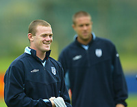 Photo Aidan Ellis.<br />England training at the cliff in Manchester.<br />04/09/2003.<br />Wayne Rooney with Matthew Upson in the background