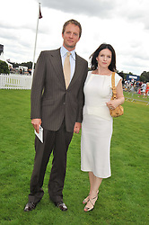 Actor RUPERT PENRY-JONES and his wife actress DERVLA KIRWAN at the 25th annual Cartier International Polo held at Guards Polo Club, Great Windsor Park, Berkshire on 26th July 2009.
