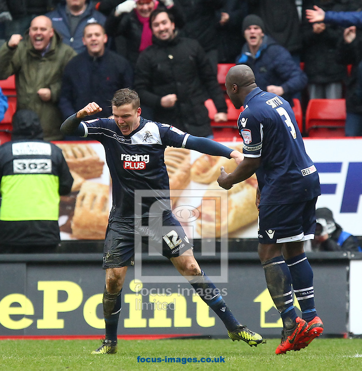 Picture by John  Rainford/Focus Images Ltd +44 7506 538356.16/03/2013.Shane Lowry of Millwall celebrates his goal with skipper Danny Shittu during the npower Championship match at The Valley, London.