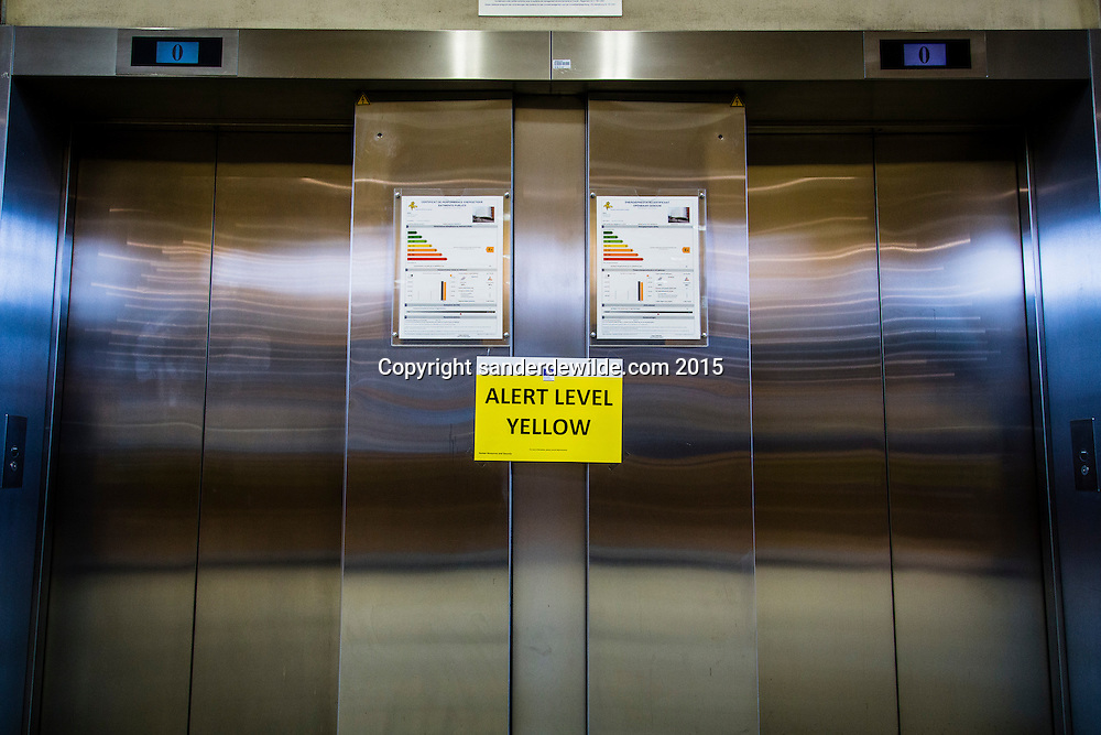 Due to terrorist threats the Alert level within the EU buildings is at alert level yellow, with higher security measures at all entrances and signs like this on the elevators.