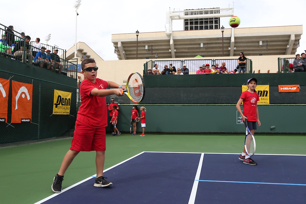 March 1, 2014, Palm Springs, California: <br /> Kids participate in a tennis clinic during Kids Day at the Indian Wells Tennis Garden sponsored by the Coachella Valley National Junior Tennis and Learning Network.<br /> (Photo by Billie Weiss/BNP Paribas Open)
