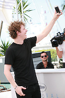 Norman Thavaud, taking a selfie photo at the Mon Roi film photo call at the 68th Cannes Film Festival Sunday May 17th 2015, Cannes, France.