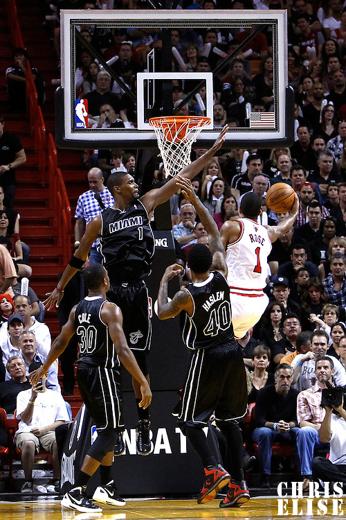 29 January 2012: Chicago Bulls point guard Derrick Rose (1) goes for the layup against Miami Heat power forward Chris Bosh (1) during the Miami Heat 97-93 victory over the Chicago Bulls at the AmericanAirlines Arena, Miami, Florida, USA.