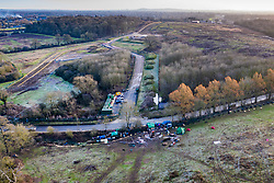 VIDEO AVAILABLE : https://we.tl/t-SQVmqbvcNl  © Licensed to London News Pictures. 29/01/2020. London, UK. A protest camp (foreground) marks the route of the High Speed Two (HS2) rail line near Newyears Green Covert a woodland area in the London Borough of Hillingdon.  A government decision is expected soon on whether the HS2 rail project will fully go ahead with some budget estimates showing a cost of £70-£80bn. Photo credit: Peter Macdiarmid/LNP