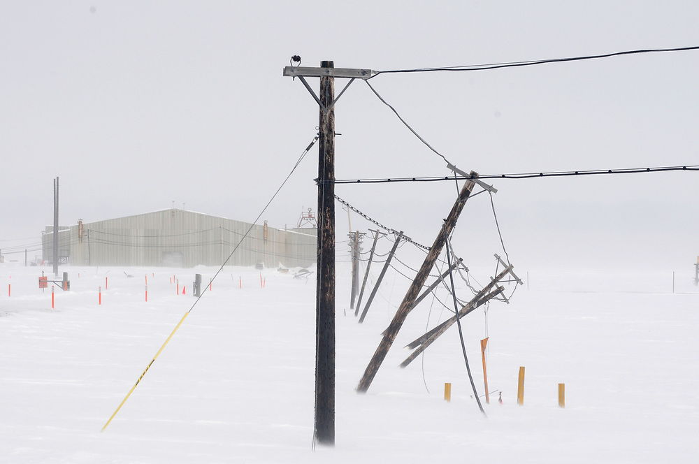 Alaska, Barrow. Tilting poles due to global warming and receding permafrost.  Spring 2008