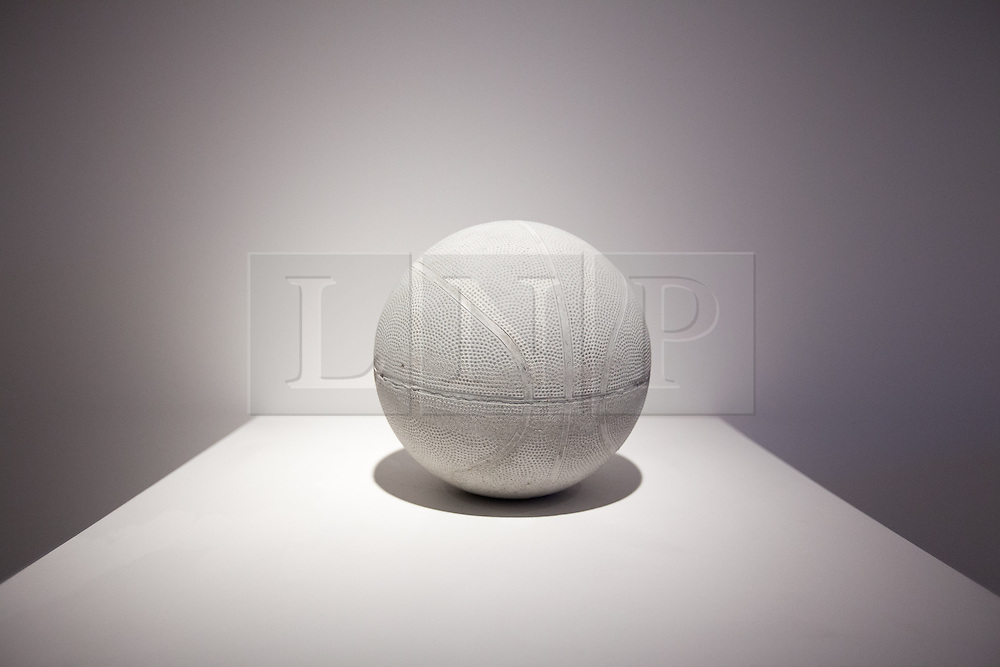 © Licensed to London News Pictures. 20/06/2013. London, UK. 'Basketball' (2012) a sculpture made using reconstituted concrete from the West Bank-Israel 'apartheid wall' by Palestinian artist Khaled Jarrar is seen at the press view for a new exhibition at the Ayyam Gallery in London today (20/06/2013). The exhibition, entitled 'Whole in the Wall', uses cement taken by Khaled from the 700km long apartheid wall that separates the West Bank from the State of Israel. Photo credit: Matt Cetti-Roberts/LNP