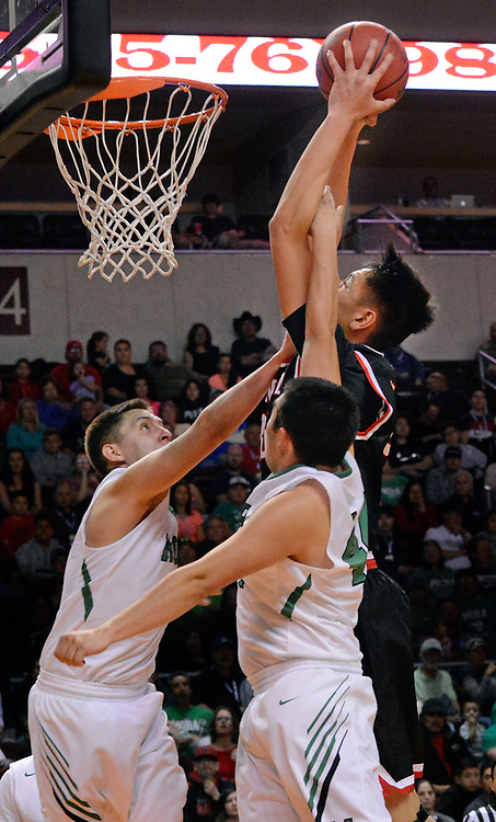 jt030817k/sports/jim thompson/ Mora's #34 Ryan Duran  and #40 Dominic Pacheco try to stop Menual's #35 Michael Ou from dunking the ball in their game Wednesday night at the Santa Ana Star Center.   Wednesday Feb. 08, 2017. (Jim Thompson/Albuquerque Journal)